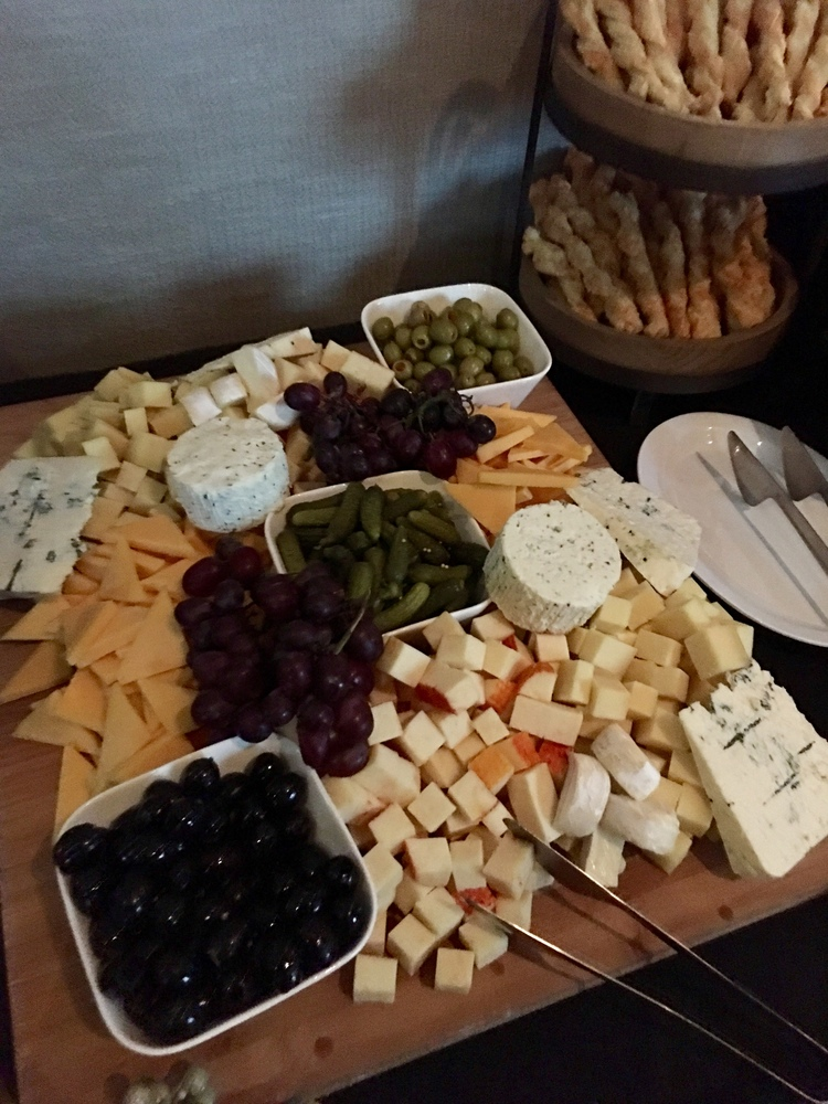 grapes, black and green olives, cheese and pickles
