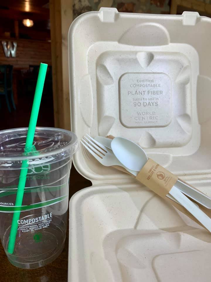 Compostable To Go Box, Silverware Set, Cup and Paper Straw on Table